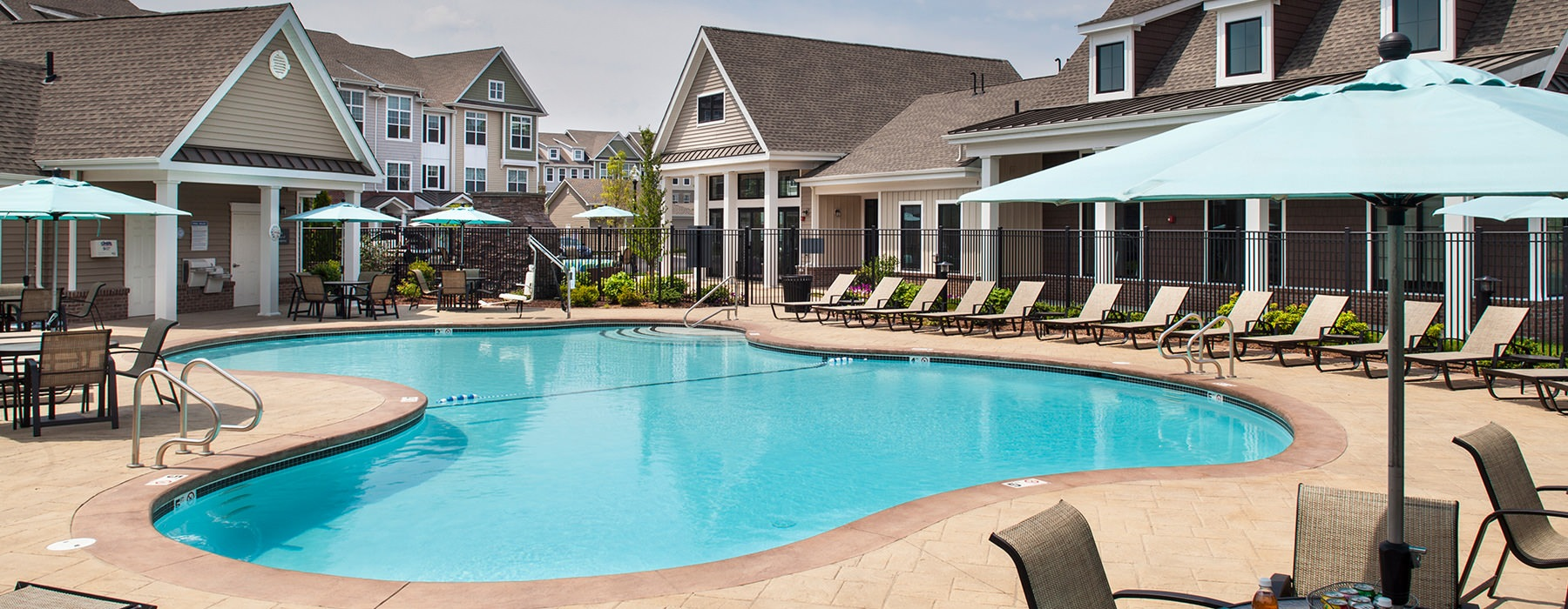 sparkling pool outside resident clubhouse